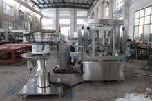 蝴蝶蓋壓蓋機(8000瓶每小時塑料瓶隱形眼鏡清洗液壓蓋機)